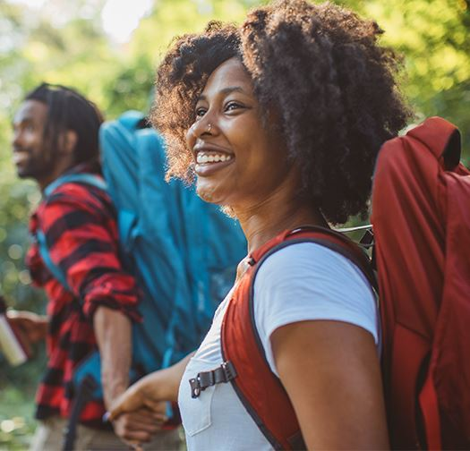 African American couple on a hike holding hands and smiling
