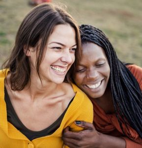 Multiracial friends smiling and enjoying each others company