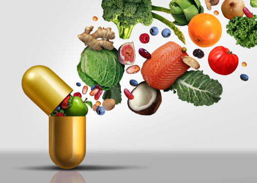 Clean eating food bursting out of a pill/vitamin